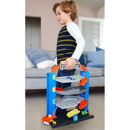 Jucarie Hot Wheels by Mattel City Garajul cu cascadorii cu 1 masinuta*